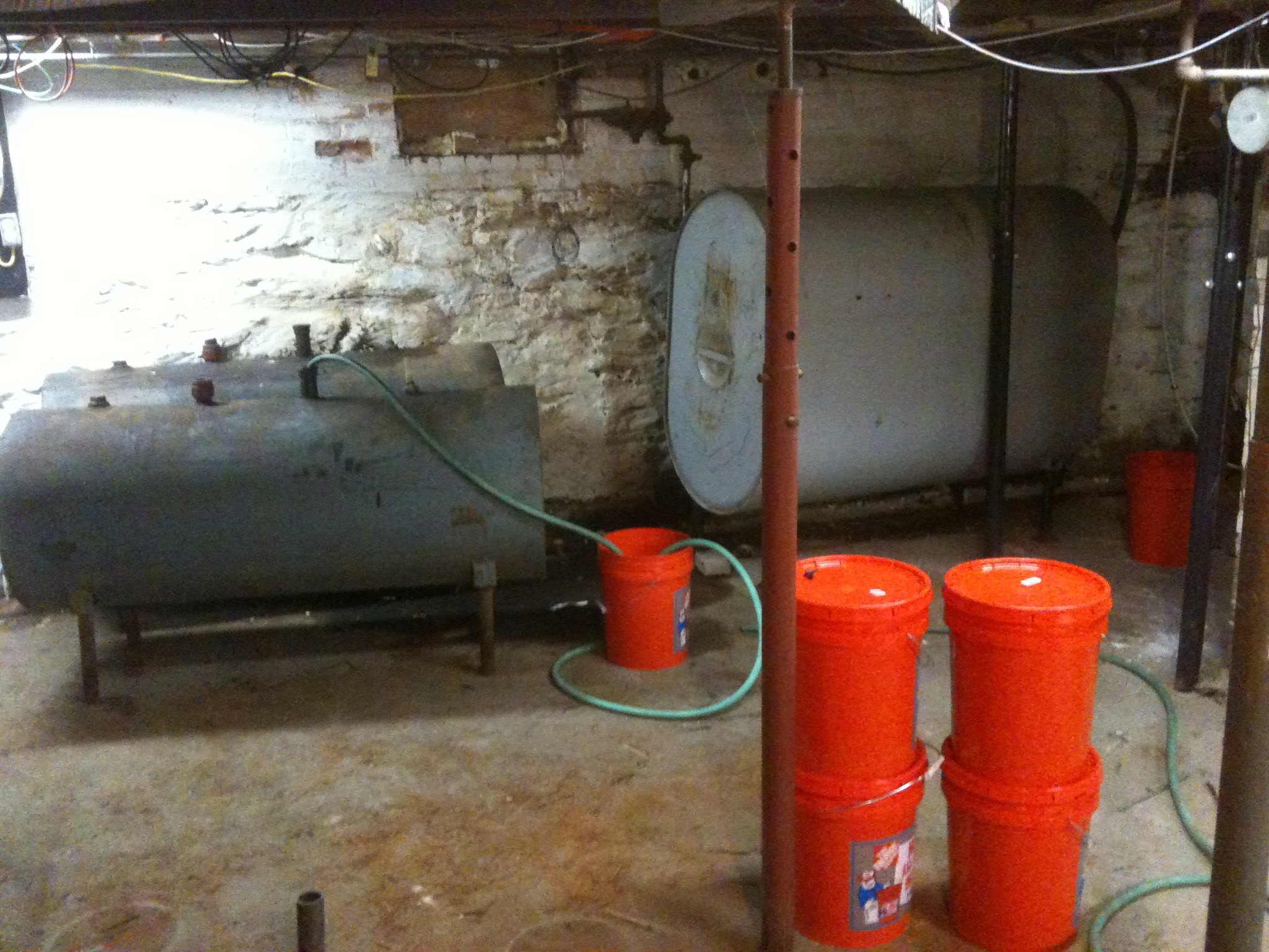 basement with three oil tanks one containing 65 gallons of k1 and
